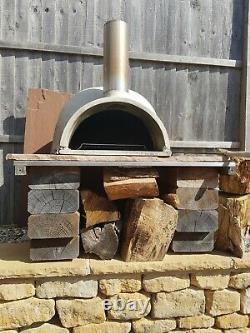 Brick outdoor wood fired pizza oven